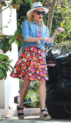 Reese Witherspoon in a floral dress, chambray shirt, Panama hat and wedge heels - click ahead for more summer outfit ideas!