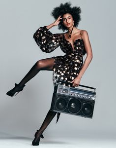 Imaan Hammam models Saint Laurent dress and earring with Oscar Tiye pumps