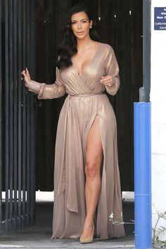 Kim Kardashian is still showing off plenty of skin. Kim K wore a revealing nude … Kim Kardashian is still showing off plenty of skin. Kim K wore a revealing nude wrap dress in Los Angeles for a dressy photo shoot. Khloe Kardashian, Kardashian Photos, Kardashian Braids, Kardashian Wedding, Plus Size Dresses, Sexy Dresses, Prom Dresses, Nude Dress, Dress Up