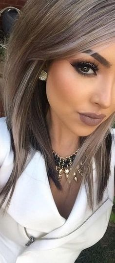 Love her makeup and the hair color. Ash brown.