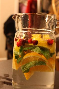 With only four ingredients, this super simple Infused Water recipe is a refreshing and cooling drink option. Jazz up your water with big, juicy slices of oranges and lemon, tart cranberries and refreshing mint. Refreshing Drinks, Fun Drinks, Yummy Drinks, Healthy Drinks, Beverages, Healthy Food, Healthy Eating, Party Drinks, Cold Drinks