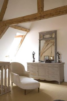 stunning chalky white room with natural beams