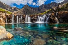 The stunning rock formations caused by erosion from the crystal clear water running down from the Cullins, the largest mountains on the Isle of Skye in Scotland, created the legendary fairy pools. Glen Brittle, a large glen at the south of the isle, is where the pools can be found.
