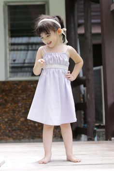 All kids turn into a little princess with this sweet dress. Delicate and adjustable spaghetti strap with a cotton lace belt under the bust line makes it very girly. The bow tied at the back makes this dress even more adorable.