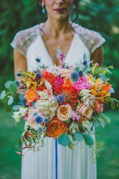 colorful tropical bouquet - photo by Brian Evans Photography http://ruffledblog.com/vibrant-eclectic-wedding-in-palm-springs #weddingbouquet #bouquets #aromabotanical