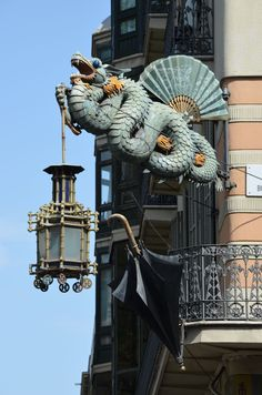 Dragon Lamp on Casa Bruno Quadros, umbrella shop, Barcelona Magical Creatures, Fantasy Creatures, Fantasy Dragon, Fantasy Art, Street Art, Mythical Dragons, Sphinx, Ange Demon, Year Of The Dragon