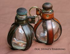 leather and glass globe bottle holster by DocStonesTinkering on Etsy