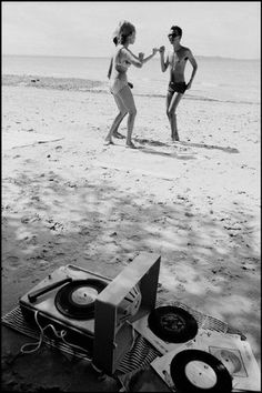 Brazil 1966 by Rene Burri (c) Magnum Photos. Dancing by record player on beach. (does this remind anyone of Moonrise Kingdom?)