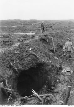 """scrapironflotilla: WWI - """"Near Le Barque, France. Captain C E W Bean, the Australian Official Correspondent, and Private Arthur W Bazley (left rear) examining German trenches captured by the 1st Australian Infantry Brigade in the 'Maze'. Note the mouth of their retreat."""
