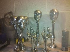 Candle holders, skulls & spray paint. I have some stars on bases; add skulls & spary paint!! Trophies!