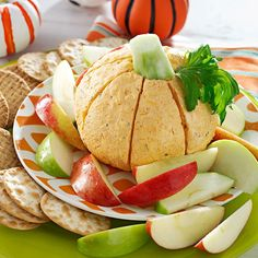 Pumpkin-Shaped Cheese Ball Recipe -Everyone will get a kick out of this creamy, savory spread. The zippy cheddar ball can be made a day ahead. —Suzanne McKinley, Lyons, Georgia