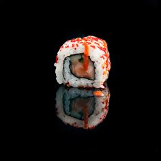 Dynamite / salmon, cucumber, tobiko, spicy sauce and sesame
