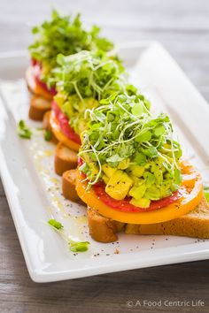 If you love avocados, I bet you will love avocado toast with tomatoes. Add a squeeze of lime. Enjoy for breakfast, and add a poached egg. Microgreens to top