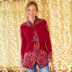 """SALZBURG SWING CARDIGAN--Easy as a cardigan, but far more festive, our swingy  sweater is intarsia knit with a bright folkloric pattern. Snap close, cutaway hem. Imported. Sundance exclusive. Superfine merino wool. Hand wash. Sizes S (4 to 6), M (8 to 10), L (12 to 14), XL (16); 27""""L."""