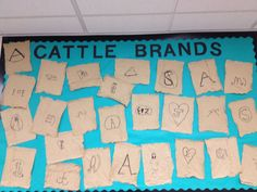 Students created cattle brands on wrinkled paper sacks