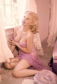vintage pinup girl sitting in the window
