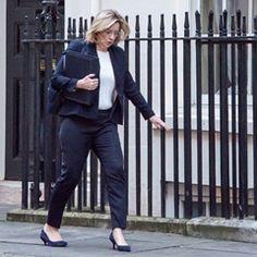 UK Home Secretary Amber Rudd trips on way to Cabinet Meeting