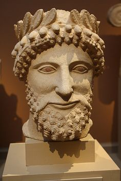 An Exceptional Cypriot (Classical) Limestone Head of a Bearded Man Wearing a Wreath 5th cent. BCE