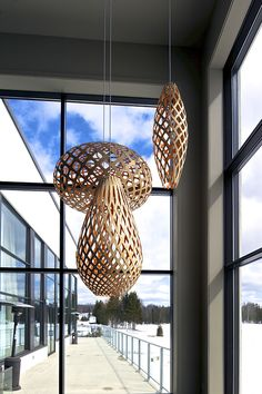 Pendants from the David Trubridge lighting collection hang above the staircase leading from the restaurant down to the spa and lake outside....