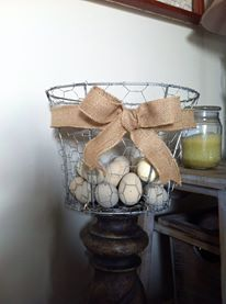An old lamp Shade turned chicken wire egg basket!