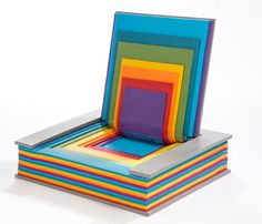This Rainbow Book Chair designed by Chen Liu is kinda fun. I think that it would be really cool in the kids section of a library or a school for a more playful atmosphere.