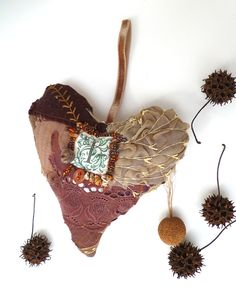 Brown heart IV large fiber art ornament in brown by Cesart64