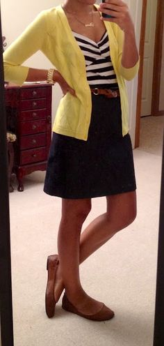 outfit: white / navy-blue striped top, navy-blue miniskirt, tan belt, yellow cardigan, tan flats