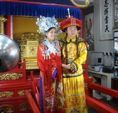 Bride and Groom Wearing The Traditional Chinese Wedding Attire