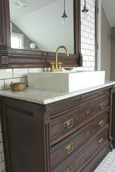 :: Havens South Designs :: loves this chest conversion with its marble top and elevated sink to preserve drawer space