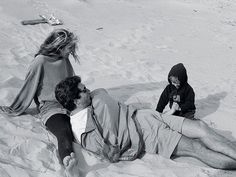 Carolyn Bessette and John Fitzgerald Kennedy Jr with John's godchild Phineas Martha's Vineyard, 1996