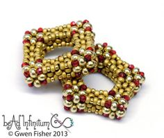Two links in gold and red crystal