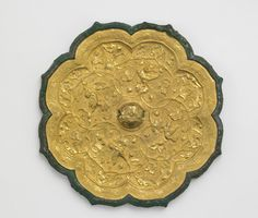 Foliated mirror with birds and floral scrolls late century Early or mid-Tang dynasty Cast bronze and applied gold plaque with repoussé, chased, and ring-punched decoration W: D: cm China Freer, Ancient Artifacts, Historical Artifacts, Stone Age Art, China Art, China China, Bronze Mirror, Chinese Design, Silk Road, Chinese Antiques