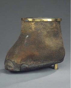 Neither Ivory, Tortoise nor horn...just didn't know where to put it! An Edwardian brass mounted hippopotamus foot waste paper bin  Circa 1910  15in. (38cm.) high
