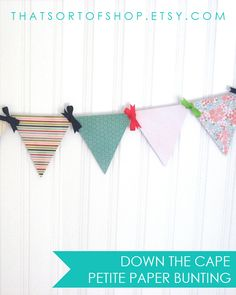 Enjoy summer at the shore all year long with this breezy bunting. Features patterns inspired by preppy summer decor and fashion including stripes, faux beadboard, flowers, and eyelet lace in a color palette of navy, bright pink, lime green, and aqua blue.