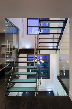 Stairs that make you feel like you're walking on air! Contemporary, Urban luxury home design inspiration! Hoxton Homes - Butterfly Showhome now building in WestPointe of Windermere Modern Staircase, Staircase Design, Beautiful Home Designs, Beautiful Homes, Space Saving Staircase, Glass Stairs, Luxury Homes