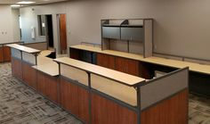 Custom reception desk for a school district in IA featuring an ADA accessible counter.