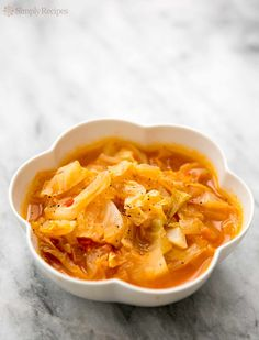 Cabbage Soup! How to make simple cabbage soup that is healthy and nourishing with cabbage, chicken stock, onions and tomatoes. On SimplyRecipes.com