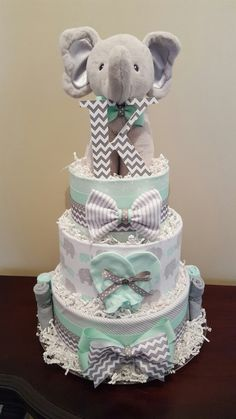 Mint green and grey elephant diaper cake.  Baby shower centerpiece gift. Check out my Facebook page Simply Showers for more pics and orders.
