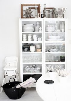 I would rather have this kind of storage for all my pretty dishes than hide them in a conventional kitchen cabinets..