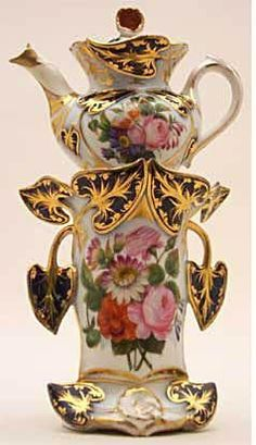 Teapot #410 Tall oval with large royal blue and gold leaves extending from the sides, roses painted on white center. Acquired in Florence