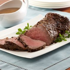 A seasoning rub of Peppercorns, Italian Seasoning and Ground Mustard forms a flavorful crust for beef tenderloin and seasons the accompanying gravy.