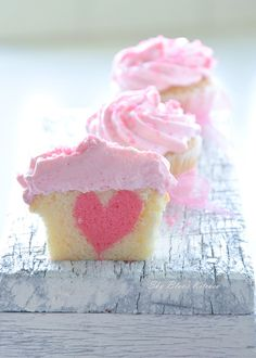 These Valentine's Day heart cupcakes are simple adorable! Cut these cupcakes from any side and end up with a heart on the inside Valentine Day Cupcakes, Heart Cupcakes, Yummy Cupcakes, Valentines, Vanilla Cupcakes, Filled Cupcakes, Sweet Cupcakes, Valentine Nails, Strawberry Cupcakes