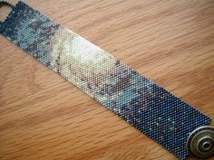 After many failed attempts, several starts and tear-aparts, here it is at last! The first in my Deep Space Series. Peyote Stitch Patterns, Seed Bead Patterns, Beaded Jewelry Patterns, Bracelet Patterns, Beading Patterns, Thread Bracelets, Bead Loom Bracelets, Woven Bracelets, Scrappy Quilts