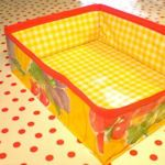oil-cloth storage baskets. Gives step by step instructions. Wipe clean.