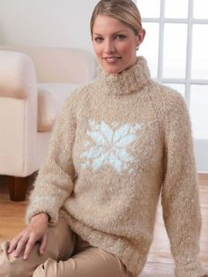 Treat yourself to extreme comfort in the Soft Snowflake Sweater. This wintery knit sweater pattern features a large snowflake motif and a cozy ribbed turtleneck.
