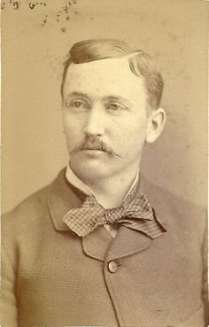 This coat style is different than the 1860s – it is buttoned close to the neck – with just enough room for his short, stand-up collar and checked tie to be seen. During the 1870's shirts were made without collars or cuffs. Generally a wardrobe of six collars and six pairs of cuffs would last a gentleman for about one year. The collars and cuffs would be washed individually, thus making the shirts last longer.