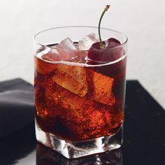 Black Cherry Cola----INGREDIENTS    1.5 oz Grey Goose Cherry Noir Flavored Vodka  3.5 oz Cola  .5 oz Grenadine  Garnish: Cherry  Glass: Rocks