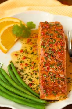 Seared Salmon with Orange-Coconut Sauce - This one is as delicious as it looks! The sweet and spicy sauce adds an amazing layer of flavor to the salmon. Salmon Recipes, Fish Recipes, Seafood Recipes, Cooking Recipes, Supper Recipes, Thai Recipes, Fruit Recipes, Fish Dishes, Seafood Dishes