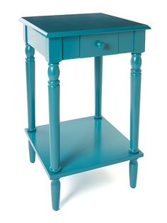An easy antidote to too much wood-tone furniture: a cottage-style end table in a glossy painted finish, like this turquoise take. Find this Convenience Concepts French Country End Table at @wayfair