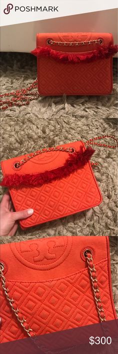 TB Tory burch orange fringe fleming In good condition, there's a stain on the inside and on the back where my jeans had rub on it. I tried cleaning the instead, hence the big spot however I didn't try cleaning the back. Tory Burch Bags Crossbody Bags